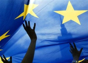 People wave a European Union flag